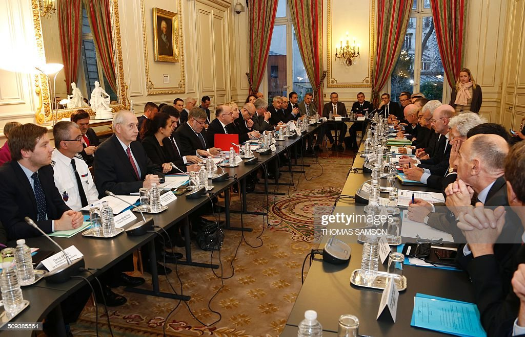 French Interior minister Bernard Cazeneuve ( 7 th L) chairs a special meeting of the Public Transport National Security Committee on the Ile-de -France region at the Hotel Beauvau in Paris, on February 10, 2016. AFP PHOTO / THOMAS SAMSON / AFP / THOMAS SAMSON