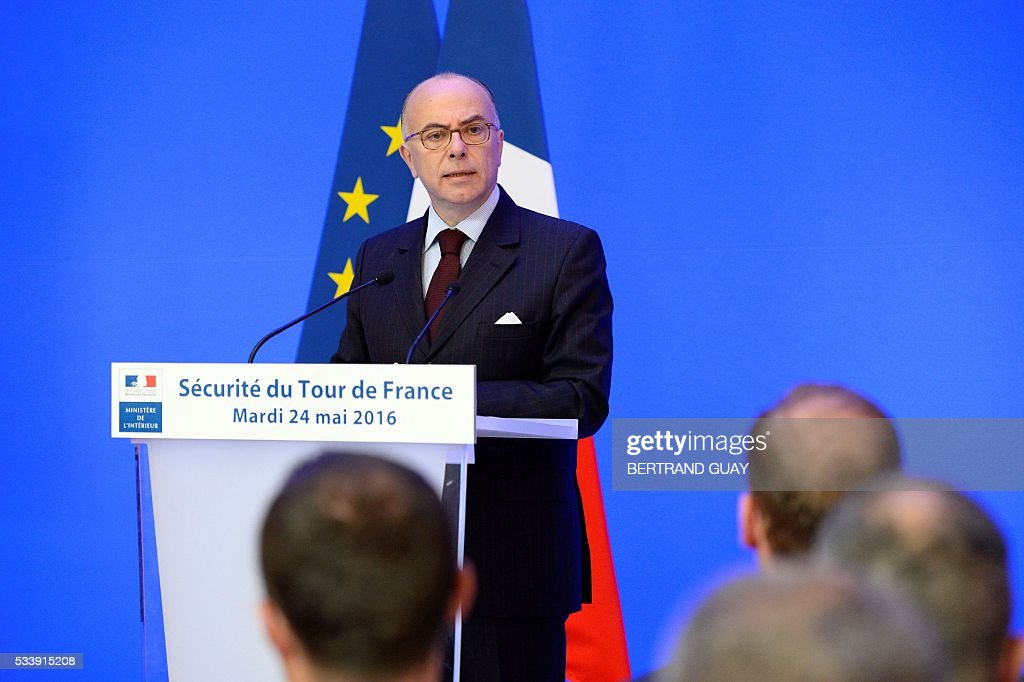 French Interior Minister Bernard Cazeneuve delivers a speech during a press conference about security measures during the Tour de France cycling race on May 24, 2016, in Paris. / AFP / BERTRAND