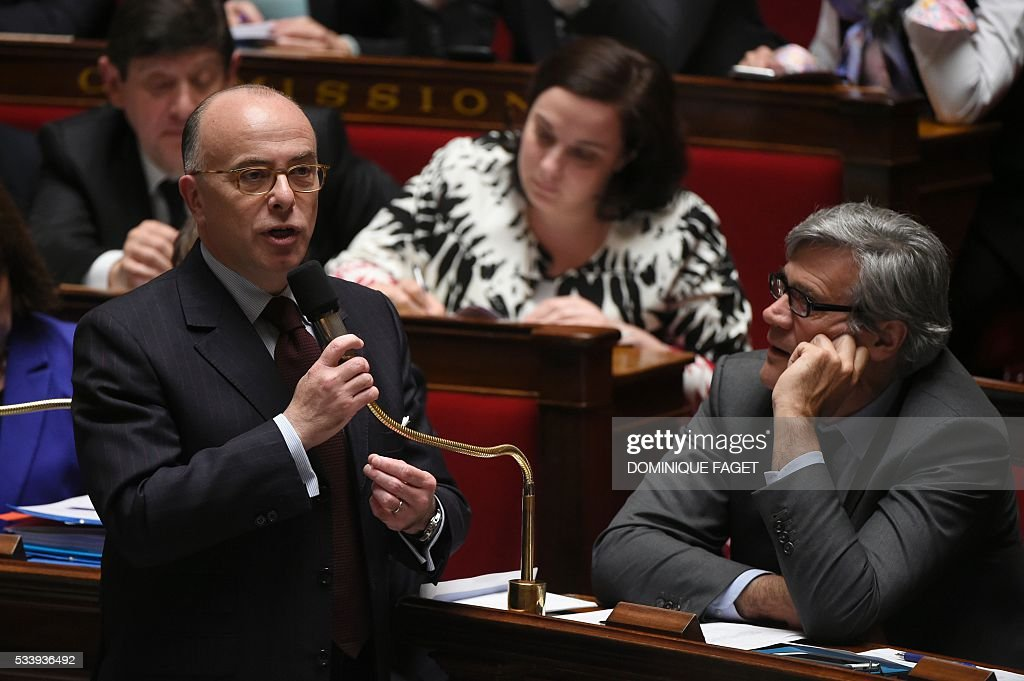 French Interior minister Bernard Cazeneuve delivers a speech during a session of Questions to the Government, on May 24, 2016 at the National Assembly in Paris.
