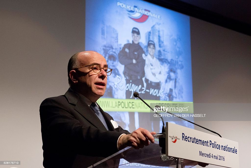 French Interior minister Bernard Cazeneuve delivers a speech during the presentation of the French police (Police Nationale) new recruitment campaign, on May 4, 2016 in Paris. / AFP / Geoffroy Van der Hasselt