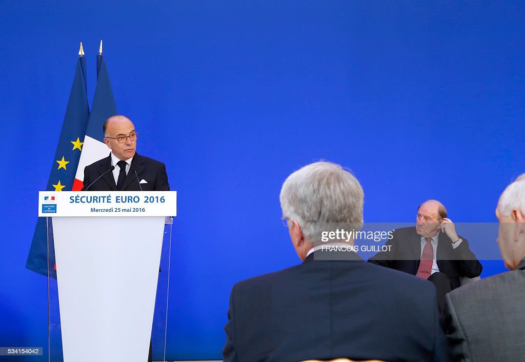 French Interior minister Bernard Cazeneuve (L) delivers a speech next to President of the organisation of the Euro 2016 Jacques Lambert (R) during a press conference on security measures for the Euro 2016, in Paris on May 25, 2016. France said on May 25, 2016 that it will deploy more than 90,000 police and security guards for Euro 2016, vowing to do 'everything possible to avoid a terrorist attack' during the football tournament that starts next month. / AFP / FRANCOIS
