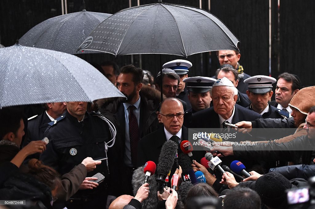 French Interior minister Bernard Cazeneuve flanked by Marseille's Mayor JeanClaude Gaudin speaks to journalists on January 14 2016 in Marseille...
