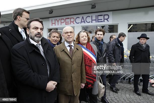 French Interior Minister Bernard Cazeneuve French Jewish central Consistory President Joel Mergui and 20 arrondissement of Paris' mayor Frederique...