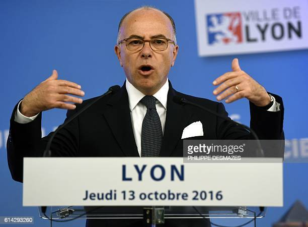 French Interior Minister Bernard Cazeneuve gestures as he delivers a speech at the end of the 7th Congress of the Labor Union of French police...