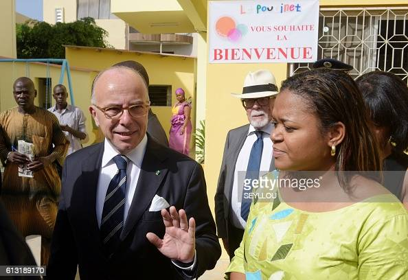 French interior minister bernard cazeneuve gestures as he - Office francais de l immigration et de l integration paris ...