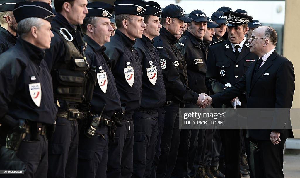 French Interior Minister Bernard Cazeneuve greets police officers during a visit in Strasbourg, eastern France, on April 29, 2016. / AFP / FREDERICK