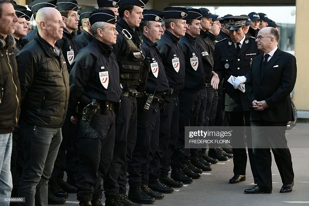French Interior Minister Bernard Cazeneuve greets police officers during a visit in Strasbourg, eastern France, on April 29, 2016. / AFP / FREDERICK