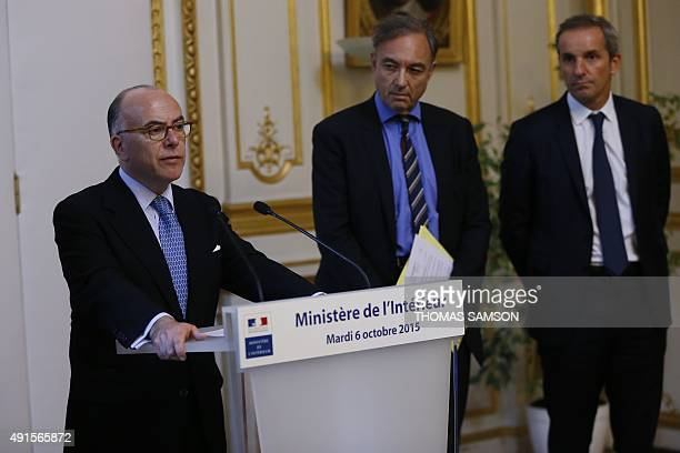 French Interior Minister Bernard Cazeneuve holds a press conference with Insurance French Association President Bernard Spitz and AFA vicepresident...