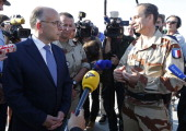 French Interior minister Bernard Cazeneuve listens to Colonel Touron deputy commander of the French Criminal Analysis Unit in front the press on July...