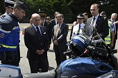 French Interior Minister Bernard Cazeneuve looks at a new Police motorbike during a road safety organisation at the entrance of the A6 highway 50...