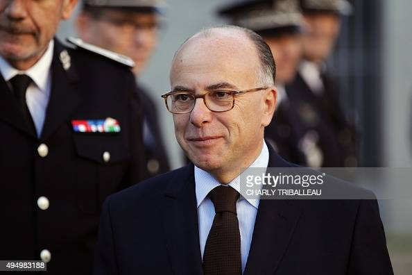 French interior minister Bernard Cazeneuve looks on as he arrives to visit the BAC on October 30 2015 in Rouen northwestern France AFP PHOTO/CHARLY...
