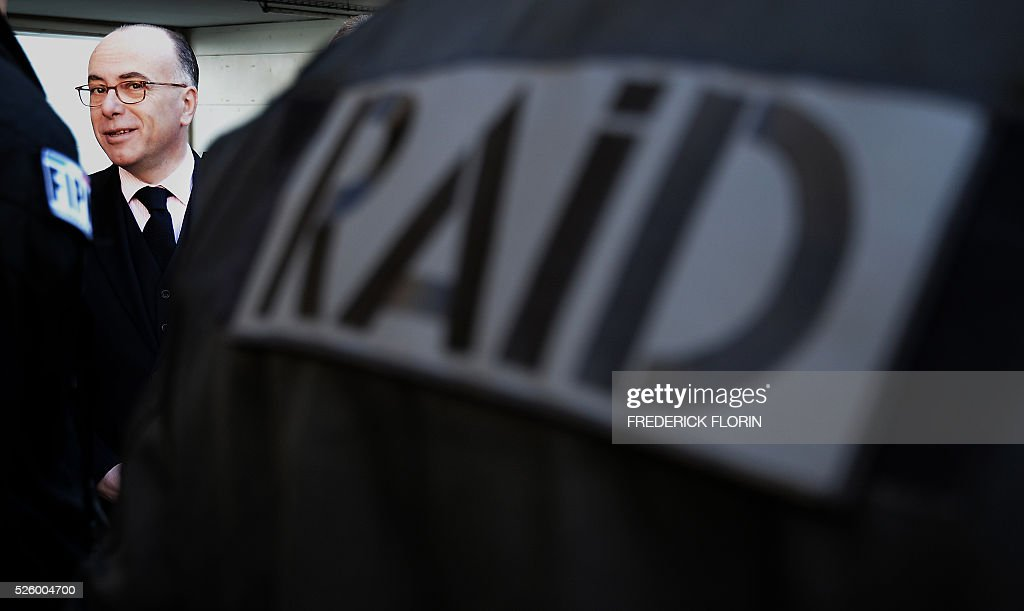 French Interior Minister Bernard Cazeneuve looks on as he greets police officers of the Recherche Assistance Intervention Dissuasion (RAID) unit during a visit to Strasbourg, eastern France, on April 29, 2016. / AFP / FREDERICK