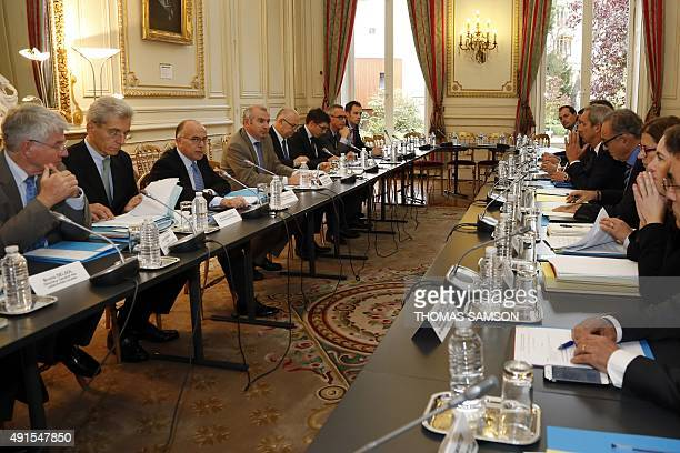 French Interior minister Bernard Cazeneuve looks on during a meeting on last flood and bad weather in the AlpesMaritimes region on October 6 in Paris...
