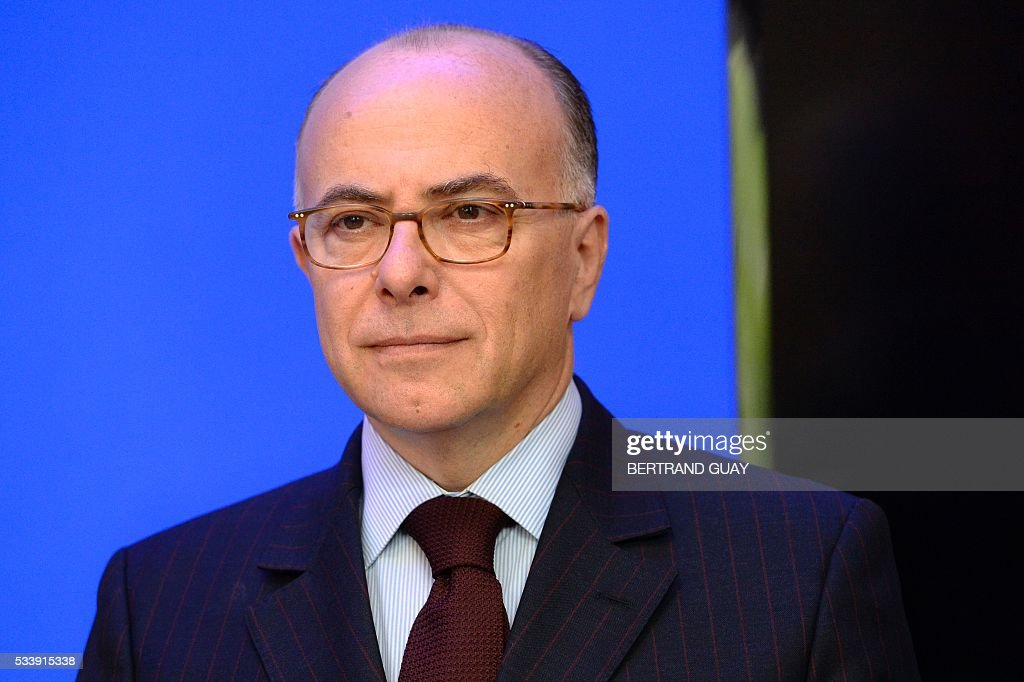 French Interior Minister Bernard Cazeneuve looks on during a press conference about security measures during the Tour de France cycling race on May 24, 2016, in Paris. / AFP / BERTRAND