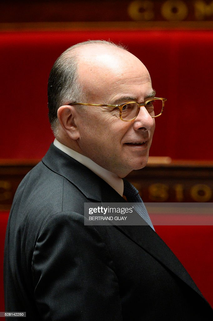 French Interior minister Bernard Cazeneuve looks on during a session of Questions to the government, on May 4, 2016 at the French National Assembly in Paris. / AFP / BERTRAND