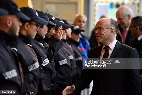 French Interior Minister Bernard Cazeneuve meets with police officers as part of a visit focused on security measures and public video protection at...