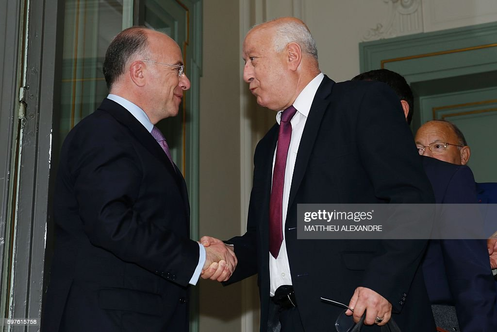French Interior Minister Bernard Cazeneuve shakes hands with the general secretary of the French Council of Muslim Faith Abdallah Zekri after a...