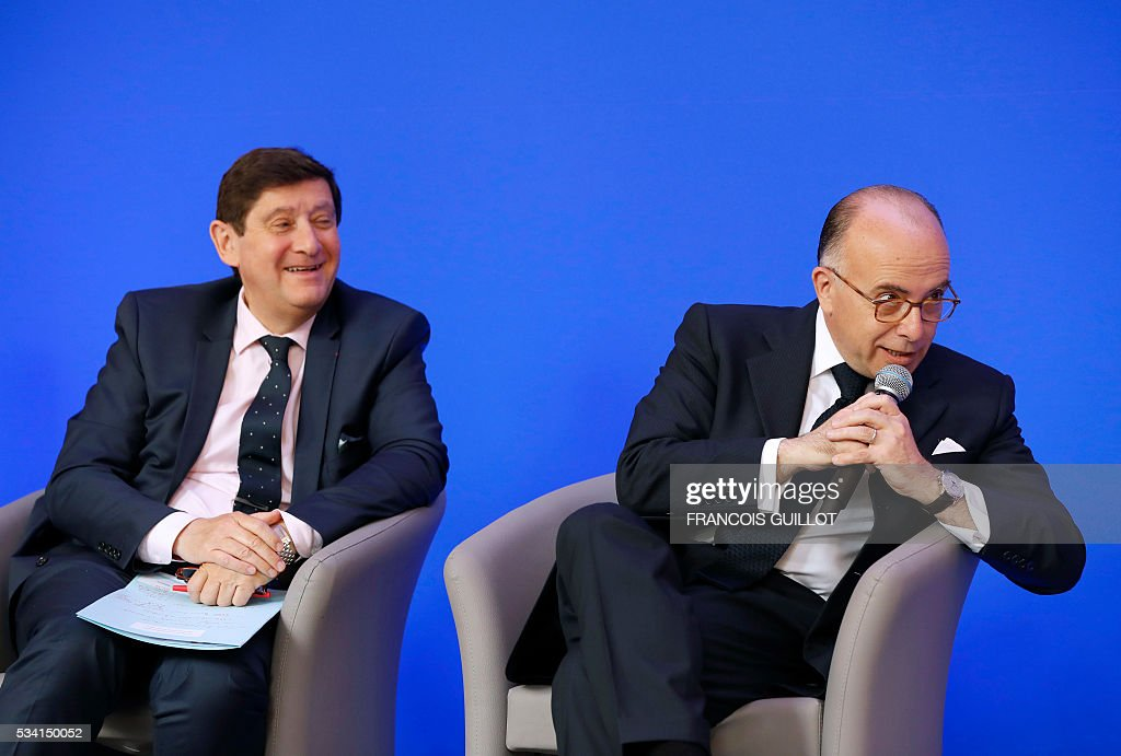 French Interior minister Bernard Cazeneuve (R) speaks next to French minister for Cities, Youth and Sport Patrick Kanner during a press conference on security measures for the Euro 2016, on May 25, 2016 in Paris. France said on May 25, 2016 it will deploy more than 90,000 police and security guards for Euro 2016, vowing to do 'everything possible to avoid a terrorist attack' during the football tournament that starts next month. / AFP / FRANCOIS