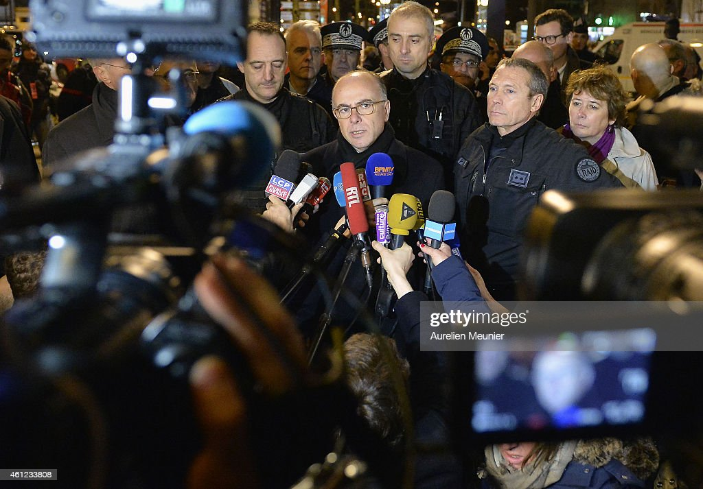 French Interior Minister <a gi-track='captionPersonalityLinkClicked' href=/galleries/search?phrase=Bernard+Cazeneuve&family=editorial&specificpeople=4205153 ng-click='$event.stopPropagation()'>Bernard Cazeneuve</a> speaks to the media after a hostage situation in a kosher deli at Port de Vincennes on January 9, 2015 in Paris, France. Police stormed the kosher deli where at least five people were taken hostage in the Port de Vincennes area of Paris. One gunman is believed to have been killed.