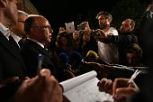 French Interior Minister Bernard Cazeneuve speaks to the media in Nice early on July 15 2016 as he visits the area where a truck ploughed into a...