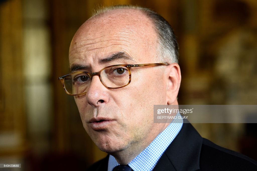 French Interior minister Bernard Cazeneuve speaks to the press after a debate concerning the labour reform at the French Senate in Paris on June 28, 2016. / AFP / BERTRAND