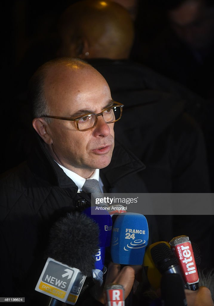 French Interior Minister <a gi-track='captionPersonalityLinkClicked' href=/galleries/search?phrase=Bernard+Cazeneuve&family=editorial&specificpeople=4205153 ng-click='$event.stopPropagation()'>Bernard Cazeneuve</a> speaks to the press at the offices of the French satirical newspaper Charlie Hebdo on January 7, 2015 in Paris, France. Twelve people were killed including two police officers as two gunmen opened fire at the offices of the French satirical publication Charlie Hebdo.