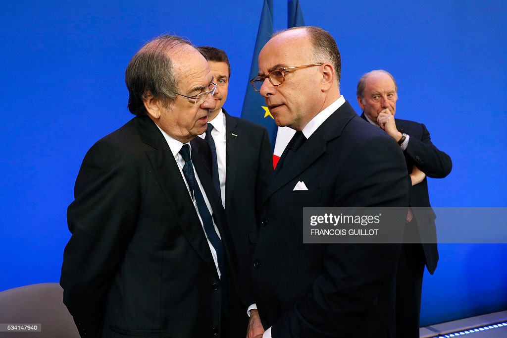 French Interior minister Bernard Cazeneuve (R) speaks with French Football Federation (FFF) president Noel Le Graet during a press conference on security measures for the Euro 2016, on May 25, 2016 in Paris. France said on May 25, 2016 it will deploy more than 90,000 police and security guards for Euro 2016, vowing to do 'everything possible to avoid a terrorist attack' during the football tournament that starts next month. / AFP / FRANCOIS