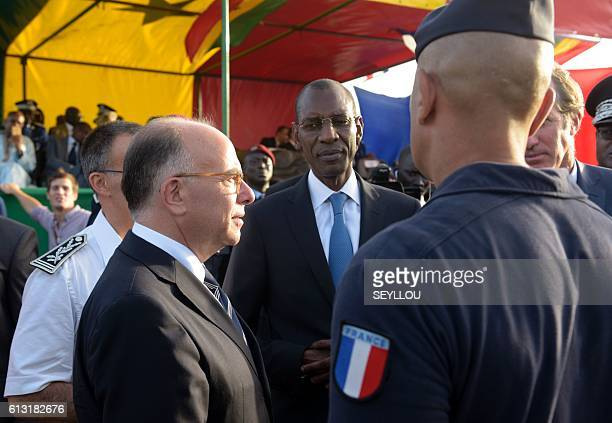 French Interior Minister Bernard Cazeneuve talks flanked by his Senegalese counterpart Abdoulaye Daouda Diallo on October 7 2016 at the Abdou Diasse...