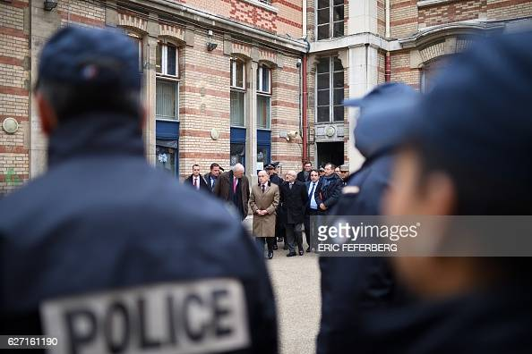 French Interior Minister Bernard Cazeneuve talks with Paris Police chief Michel Cadot as part of a visit focused on security measures at Jewish...