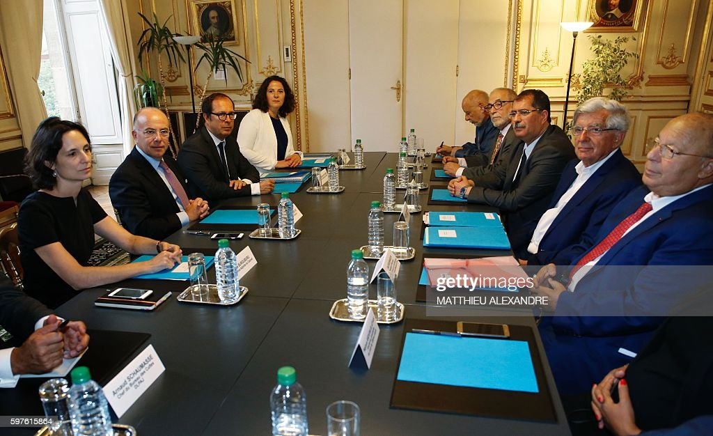French Interior Minister Bernard Cazeneuve the president of the French Council of the Muslim Faith Anouar Kbibech former French minister JeanPierre...