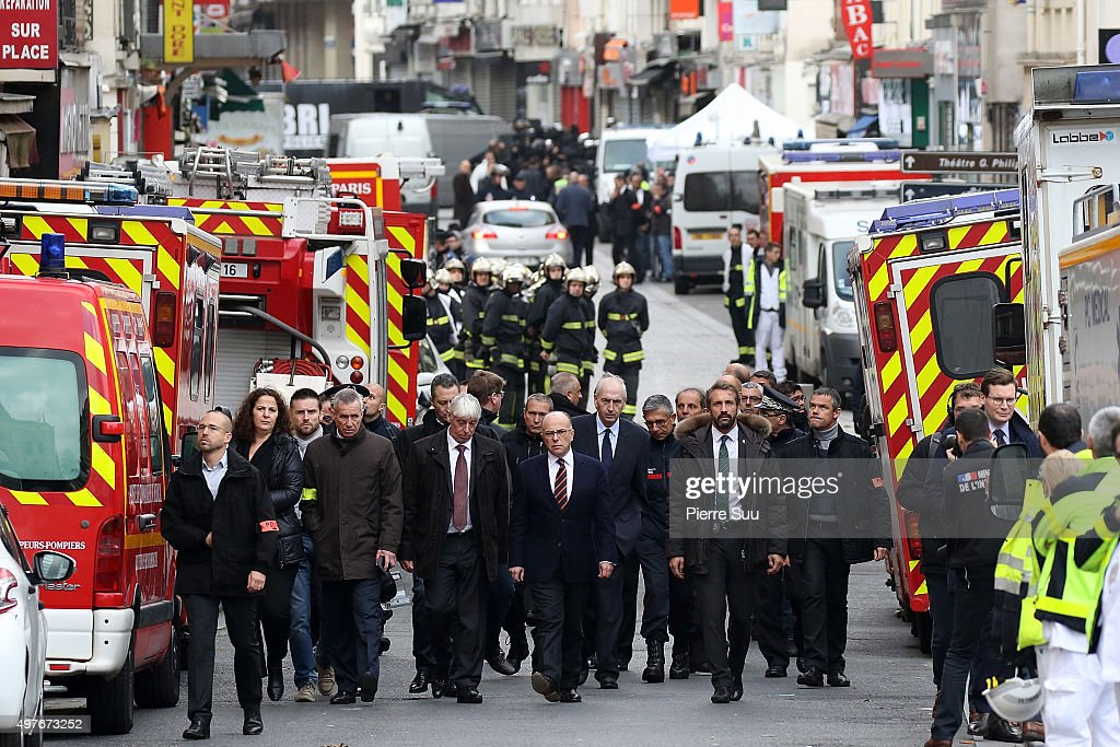 French interior minister <a gi-track='captionPersonalityLinkClicked' href=/galleries/search?phrase=Bernard+Cazeneuve&family=editorial&specificpeople=4205153 ng-click='$event.stopPropagation()'>Bernard Cazeneuve</a> visits 'Rue de la Republique' on November 18, 2015 in Saint-Denis, France. French Police special forces raided an apartment, hunting those behind the attacks that claimed 129 lives in the French capital five days ago. At least one person was killed in an apartment targeted during the operation aimed at the suspected mastermind of the attacks, Belgian Abdelhamid Abaaoud. At least five police officers have been wounded in the shootout.