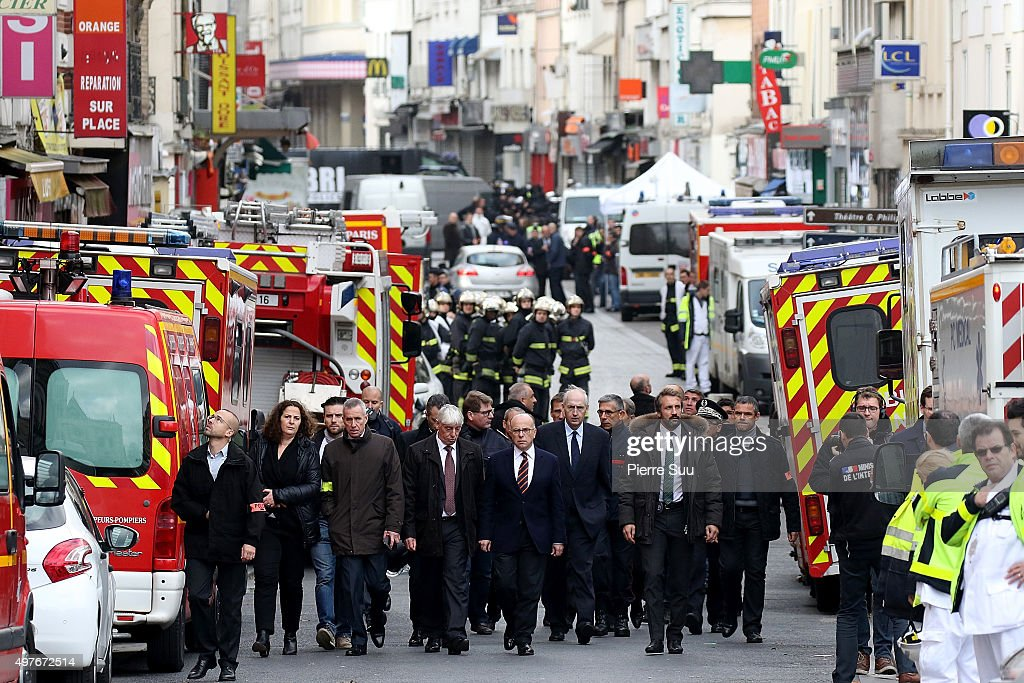 French Interior Minister <a gi-track='captionPersonalityLinkClicked' href=/galleries/search?phrase=Bernard+Cazeneuve&family=editorial&specificpeople=4205153 ng-click='$event.stopPropagation()'>Bernard Cazeneuve</a> visits the site of this morning's police raid at the 'Rue de la Republique' close to where the police raid occured earlier on November 18, 2015 in Saint-Denis, France. French Police special forces raided an apartment, hunting those behind the attacks that claimed 129 lives in the French capital five days ago. At least one person was killed in an apartment targeted during the operation aimed at the suspected mastermind of the attacks, Belgian Abdelhamid Abaaoud. At least five police officers have been wounded in the shootout.