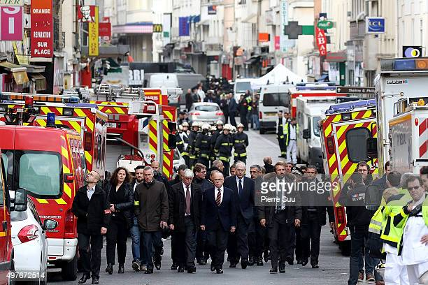 French Interior Minister Bernard Cazeneuve visits the site of this morning's police raid at the 'Rue de la Republique' close to where the police raid...