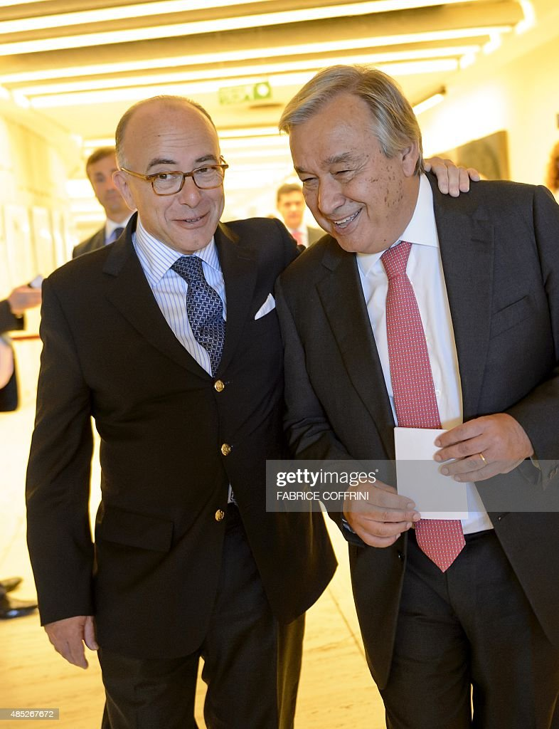 French Interior Minister Bernard Cazeneuve (L) walks next to United Nations refugee agency <a gi-track='captionPersonalityLinkClicked' href=/galleries/search?phrase=Antonio+Guterres&family=editorial&specificpeople=553912 ng-click='$event.stopPropagation()'>Antonio Guterres</a> prior to a give a press conference following their meeting to discuss the migrant crisis rocking Europe on August 26, 201 5 at the UN Offices in Geneva. AFP PHOTO / FABRICE COFFRINI