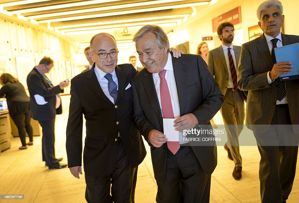 French Interior Minister Bernard Cazeneuve (L) walks next to United Nations refugee agency <a gi-track='captionPersonalityLinkClicked' href=/galleries/search?phrase=Antonio+Guterres&family=editorial&specificpeople=553912 ng-click='$event.stopPropagation()'>Antonio Guterres</a> prior to a give a press conference following their meeting to discuss the migrant crisis rocking Europe on August 26, 201 5 at the UN Offices in Geneva.