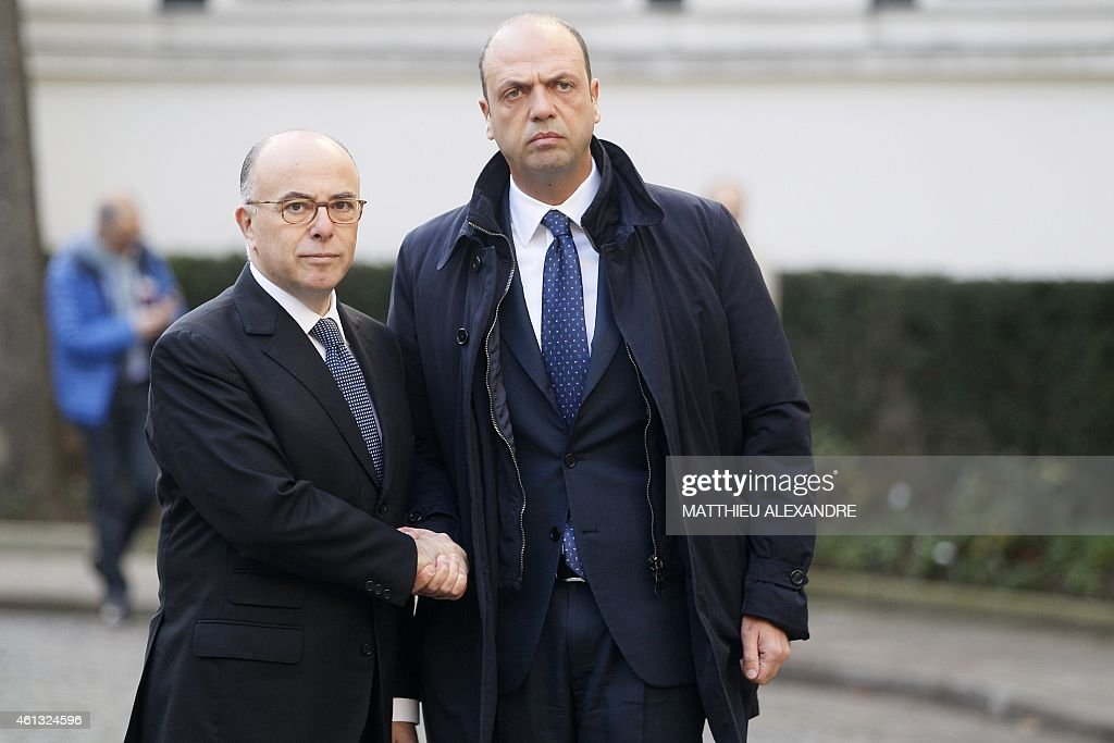 French Interior Minister Bernard Cazeneuve welcomes Italy's counterpart Angelino Alfano prior to an International meeting against terrorism on...