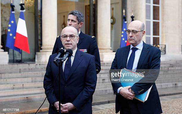 French Interior Minister Bernard Cazeneuve with the generaldirector of the French Gendarmerie General Denis Favier and French National Police...