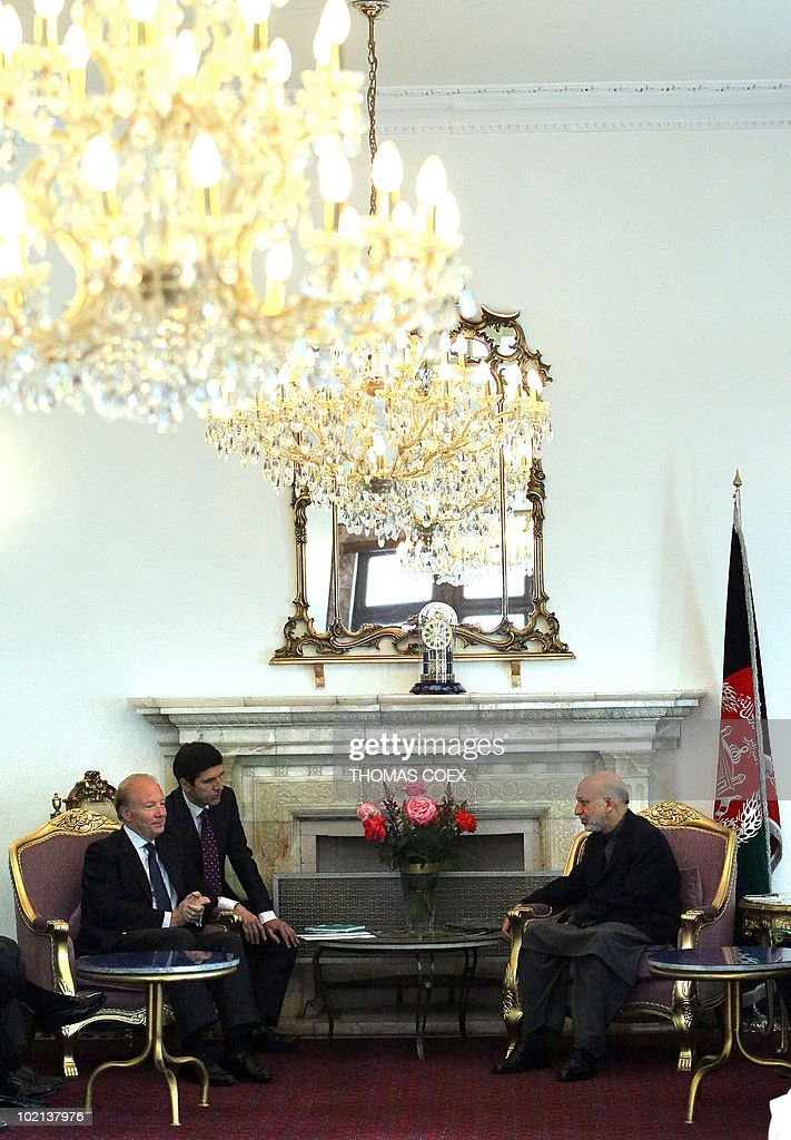 French Interior Minister Brice Hortefeux (L) speaks with Afghan President Hamid Karzai at The Presidential Palace in Kabul on May 6, 2010. Hortefeux is on a one day visit to the Afghan capital where he will meet with French policemen and soldiers who are taking part in the training of Afghan troops.