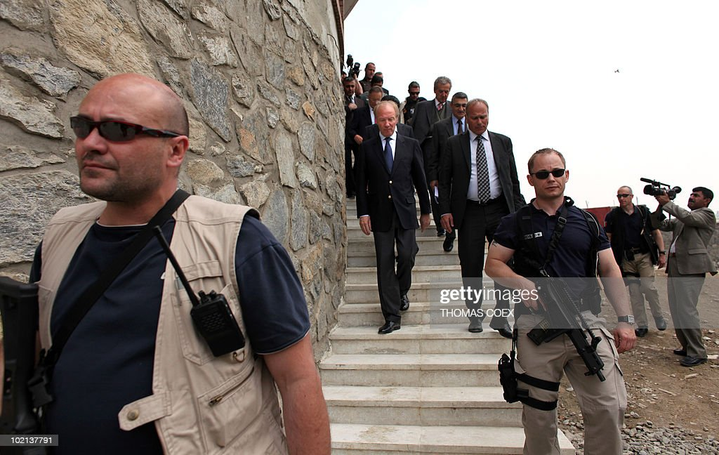 French Interior Minister Brice Hortefeux (C) visits an afghan anti-drug police office in Kabul on May 6, 2010. Hortefeux is on a one day visit to the Afghan capital where he will meet with French policemen and soldiers who are taking part in the training of Afghan troops.