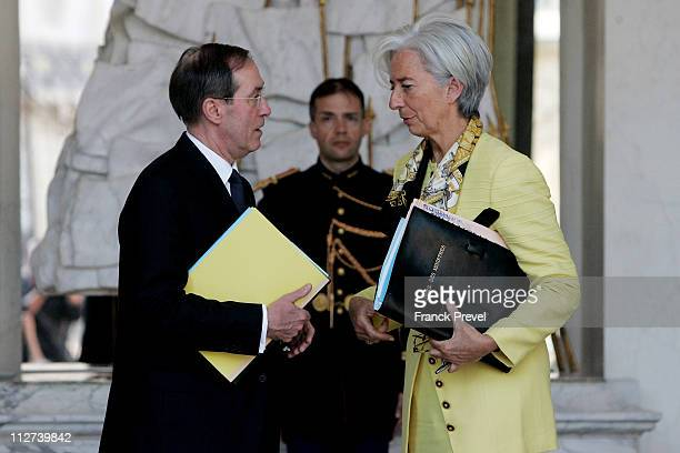 French Interior Minister Claude Gueant and France's Finance and Economy Minister Christine Lagarde leave the weekly cabinet meeting at Elysee Palace...