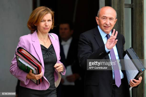 French Interior Minister Gerard Collomb and French Defence Minister Florence Parly leave a cabinet meeting at the Elysee Palace on August 9 2017 in...