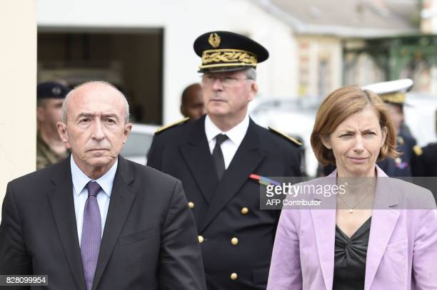 French Interior Minister Gerard Collomb and French Defence Minister Florence Parly walk after meeting with soldiers wounded in an attack this morning...