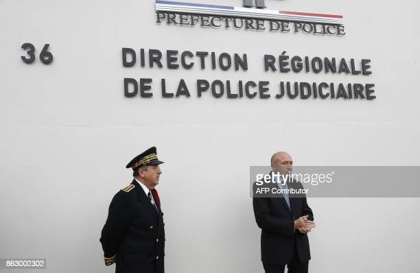 French Interior Minister Gerard Collomb and French Prefect of police Michel Delpuech pose at the entrance of the new Paris Judiciary Police...