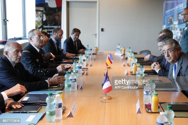 French Interior Minister Gerard Collomb and his Spanish counterpart Juan Ignacio Zoido attend a meeting at the headquarters of the French Gendarmerie...