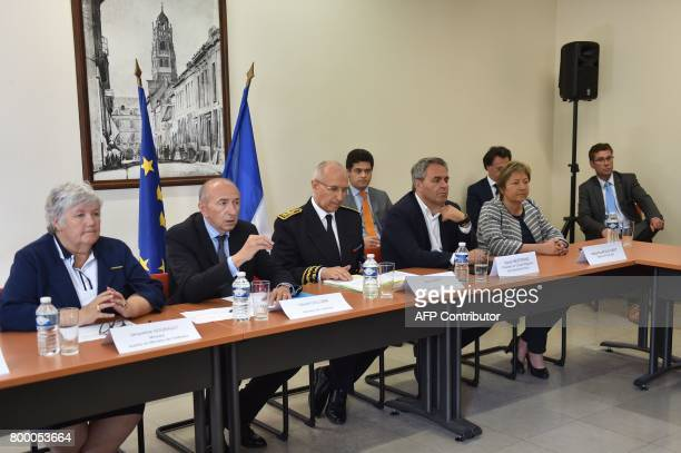 French Interior Minister Gerard Collomb flanked by French Junior Interior Minister Jacqueline Gourault PasdeCalais Prefect Fabien Sudry the president...