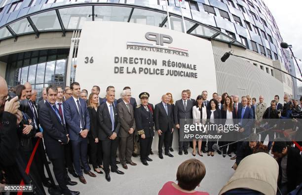 French Interior Minister Gerard Collomb French Prefect of police Michel Delpuech and Paris Judiciary Police director Christian Sainte pose at the...