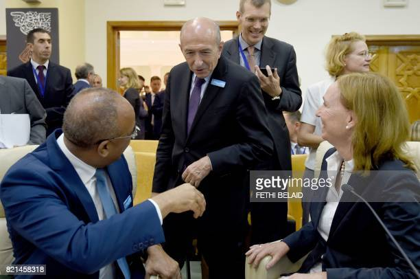 French Interior Minister Gerard Collomb greets State Secretary of the German Interior Ministry Emily Haber and Algerian Interior Minister Noureddine...