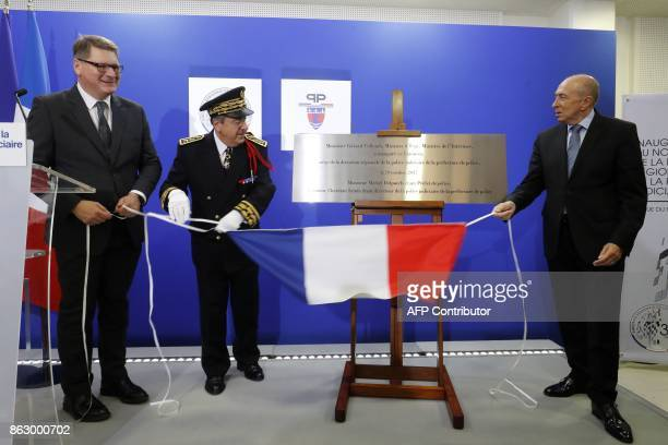 French Interior Minister Gerard Collomb Paris Judiciary Police director Christian Sainte and French Prefect of police Michel Delpuech unveil a plaque...