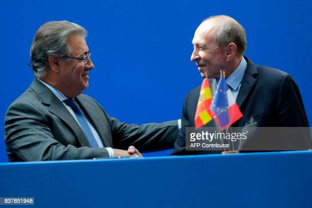 French Interior Minister Gerard Collomb shakes hands with his Spanish counterpart Juan Ignacio Zoido Alvarez after signing an agrement for the...