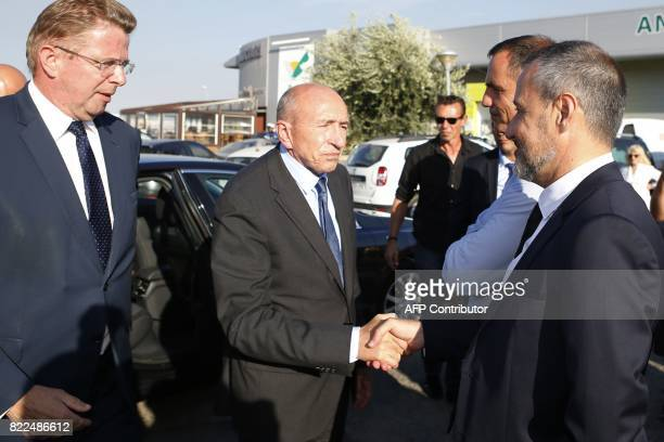 French Interior Minister Gerard Collomb shakes hands with President of the Corsican Assembly Jean Guy Talamoni next to President of the Executive...